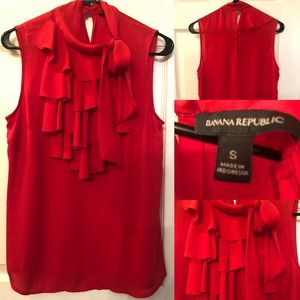 New without tags. Ruffled red blouse.